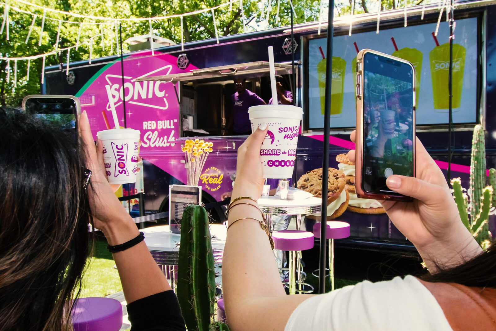 customers taking photos of their food at sonic block party marketing agency event