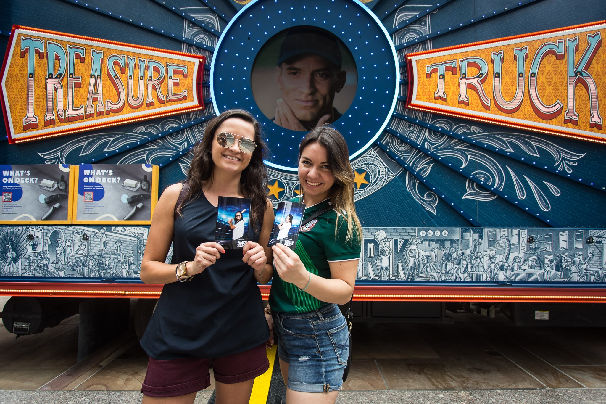 girls posing in front of amazon treasure truck brand activation services