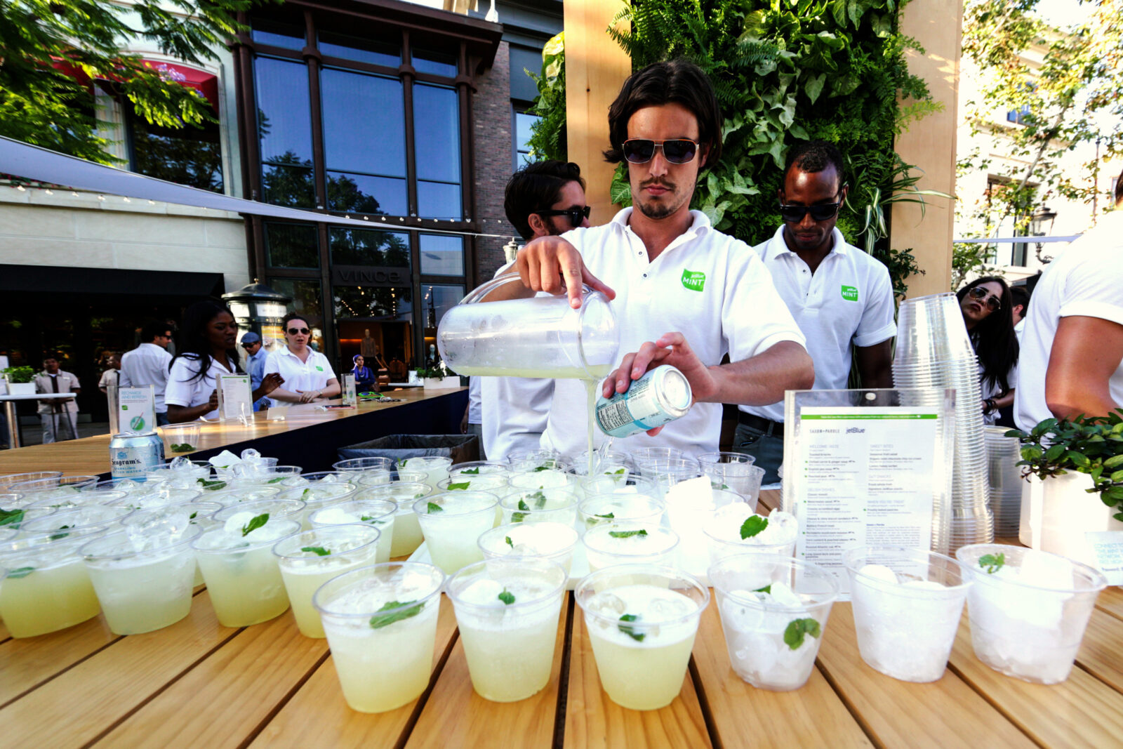 drinks being served at jetblue mint room experiential marketing event