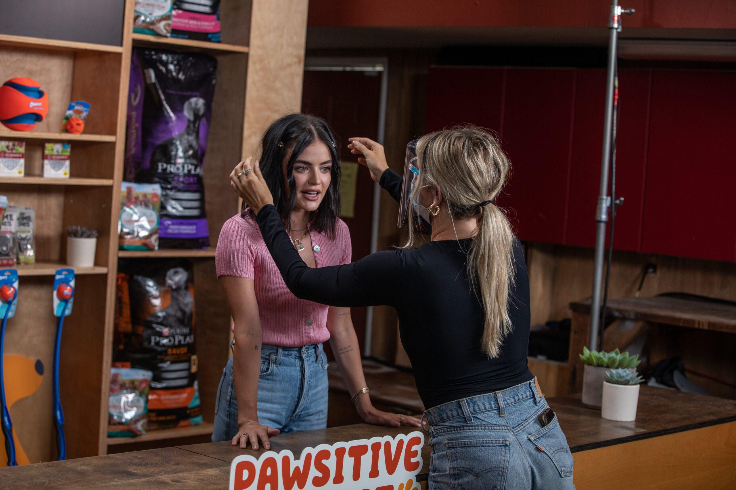 lucy hale with makeup artist during amazon pets event production