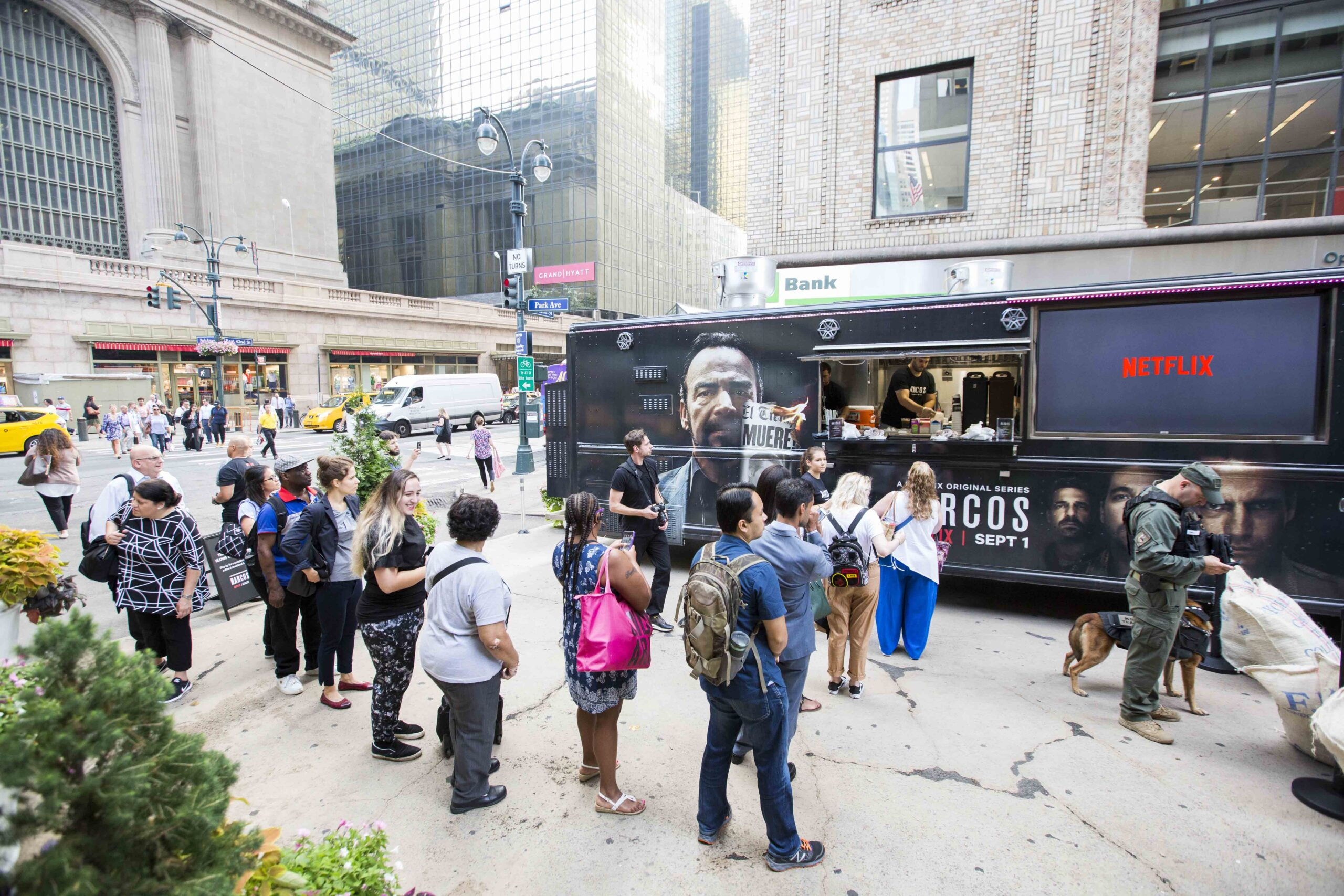 people in line at narcos food truck mobile tours