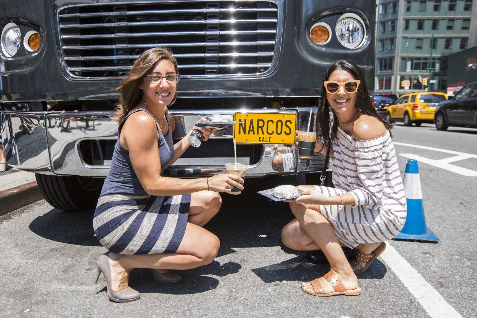 women posing with the food truck for narcos marketing agency event