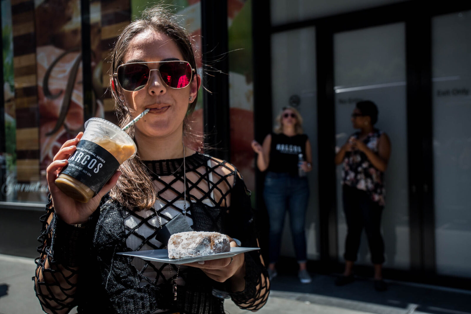 customer eating donuts at narcos food truck mobile tours