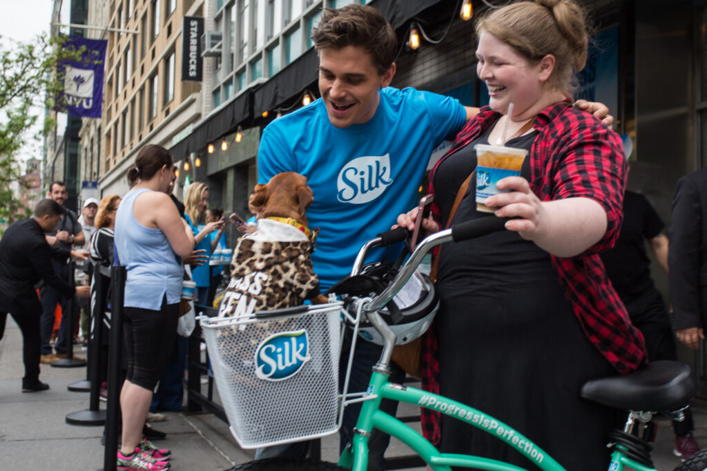 customers with dog and bike at silk progress is perfection brand experience